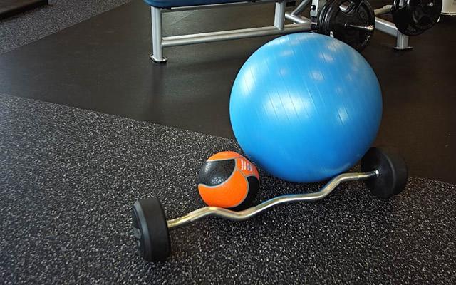 Rubber sports flooring alongside inlaid platform